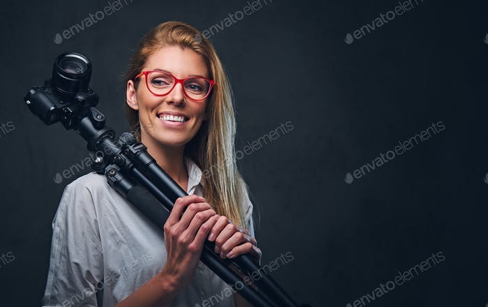 Female photographer taking pictures with professional camera.