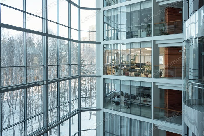 Several floors of large contemporary business center with open space offices