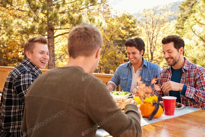 Group Of Gay Male Friends Enjoying Outdoor Meal Together