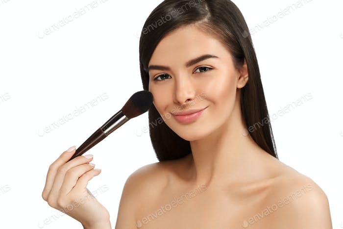 Makeup brush woman with healthy skin portrait. Young beauty model female with make up