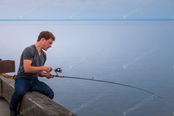 Young Fisherman Fishing Mackerel