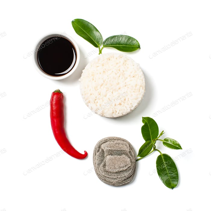 Rice, chili pepper and soy sauce on a white background.