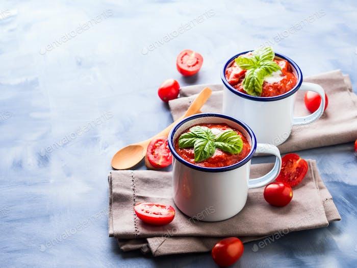 Tomato soup in enamel mugs