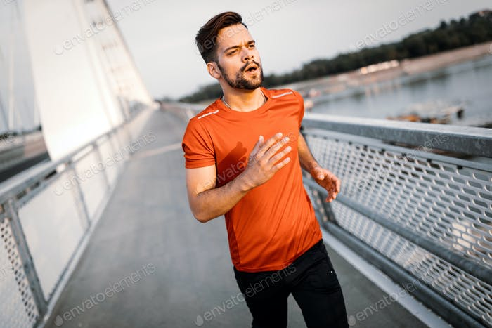 Fit young man running outdoor. Healthy lifestyle concept