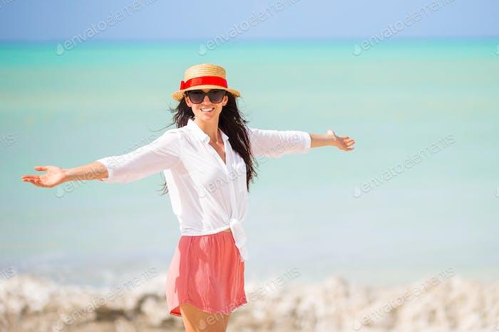 Young beautiful woman having fun on tropical seashore