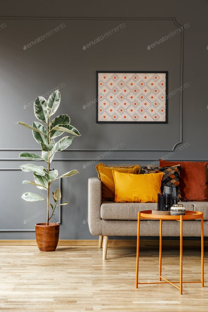 Real photo of poster with geometric pattern hanging on the wall