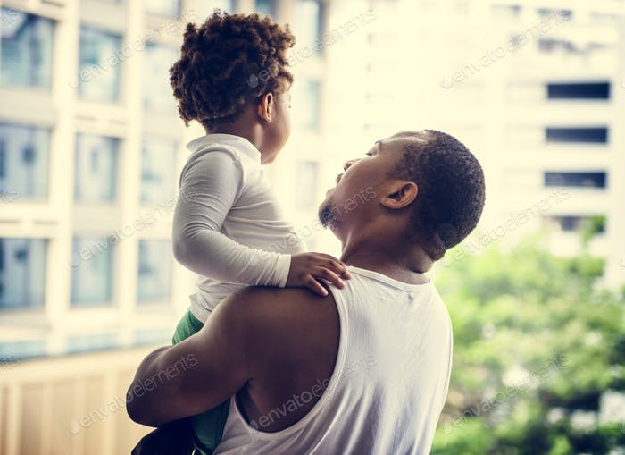 Black father enjoy precious time with his child together happiness