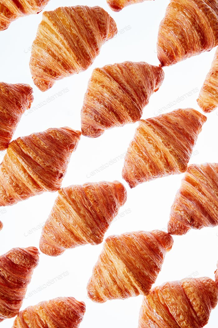 Diagonal baked goods pattern on a light background