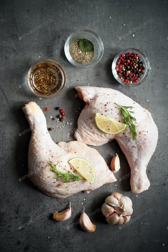 Chicken thighs on a dark background.