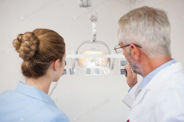 Dentist and assistant studying x-rays at the dental clinic