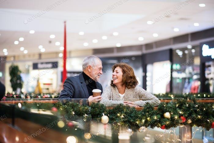 Senior couple doing Christmas shopping.