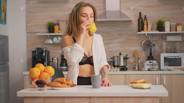 Sexy woman enjoing the morning
