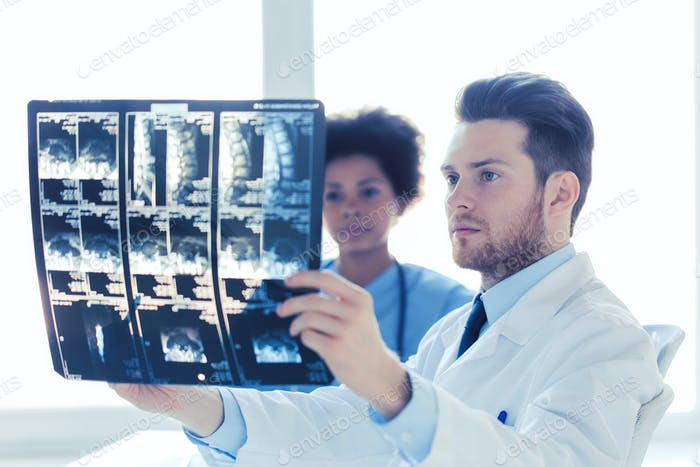 doctor and nurse looking to  x-ray at hospital