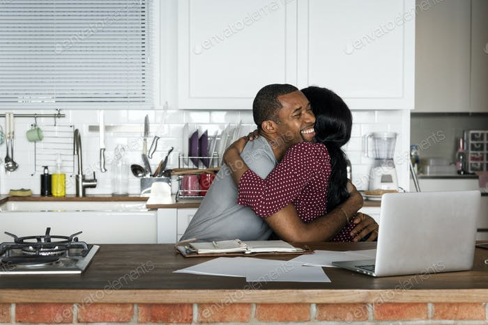 Black couple hugging together