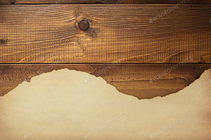 old aged paper parchment  at wooden background