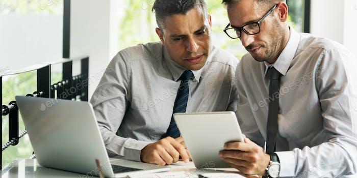 Business Colleagues Meeting Laptop Tablet Concept
