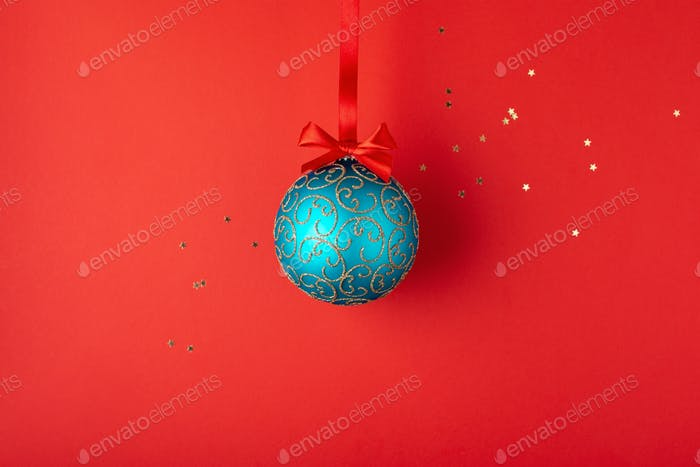 Emerald Christmas Ball on Red Background.
