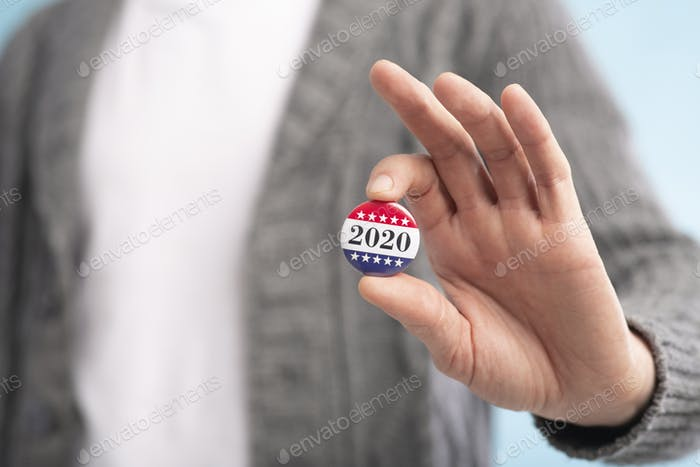 Incognito voter holding vote button on blue background