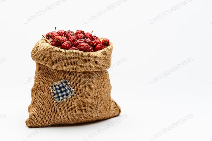 Bag with rose hips on a white background
