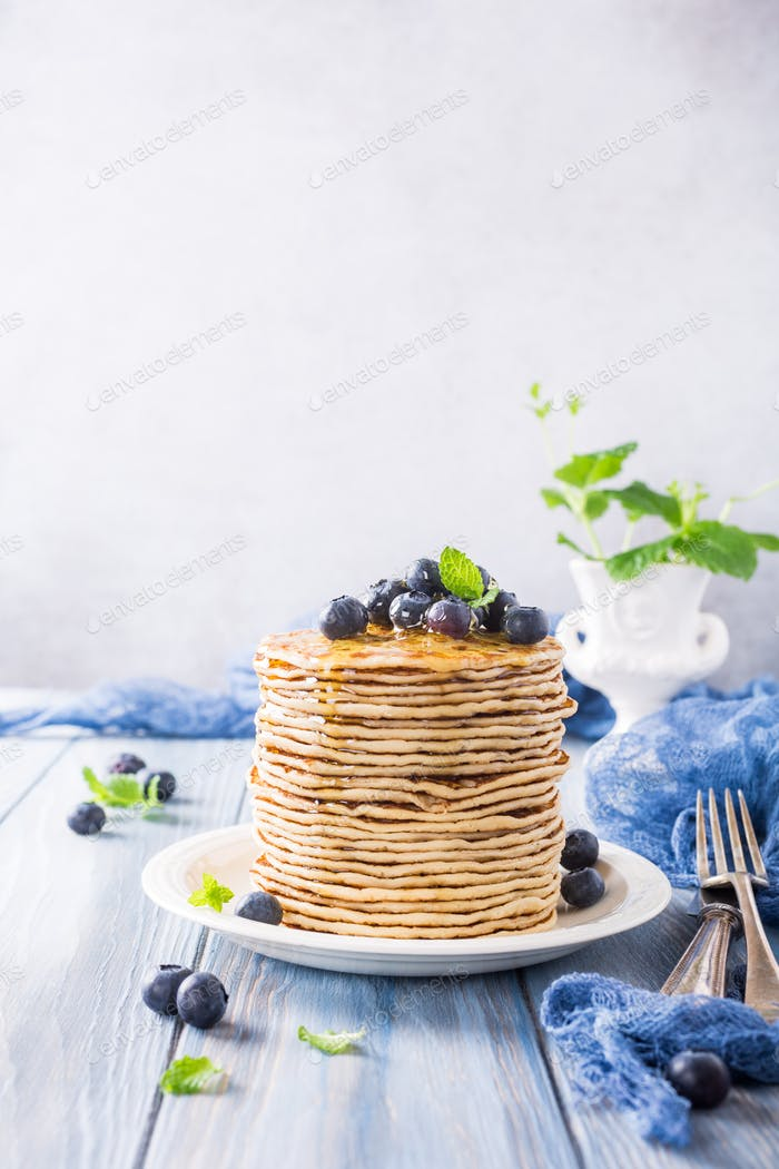 Delicious pancakes with fresh blueberries