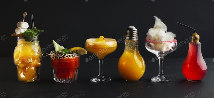 Variety of creative cocktails on black background