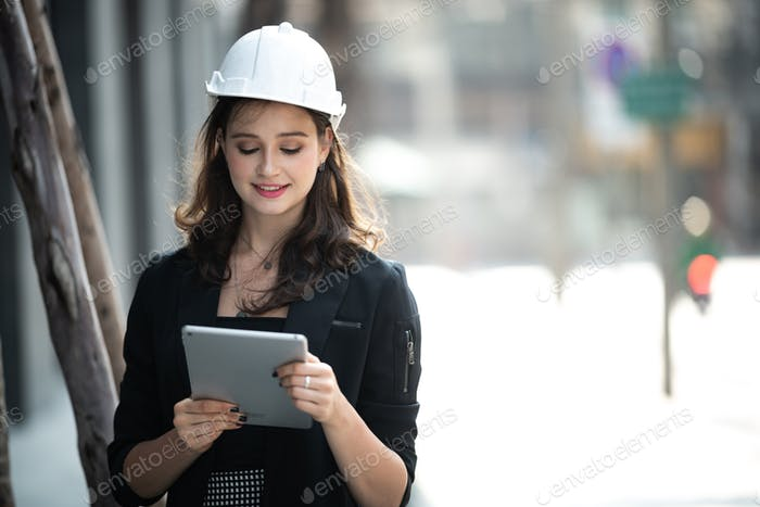 Young engineer wearing a helmet while inspecting work
