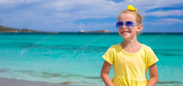 Little happy girl enjoying beach vacation