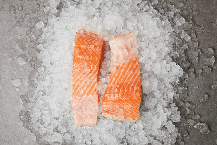 top view of slices of salmon on crushed ice