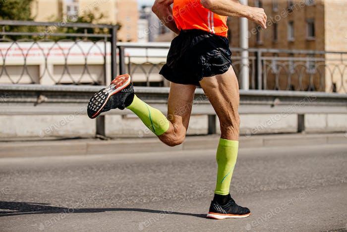 man runner in bright green compression socks