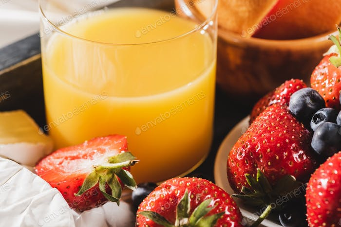 Close up View of French Breakfast With Orange Juice And Berries