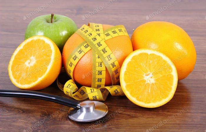 Stethoscope, fresh fruits and centimeter, concept of slimming, healthy lifestyles and nutrition
