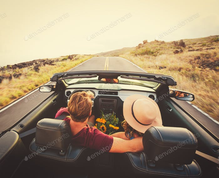 Happy Couple Driving in Convertible