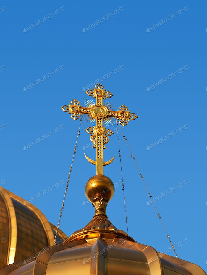 Golden crosses and blue skies