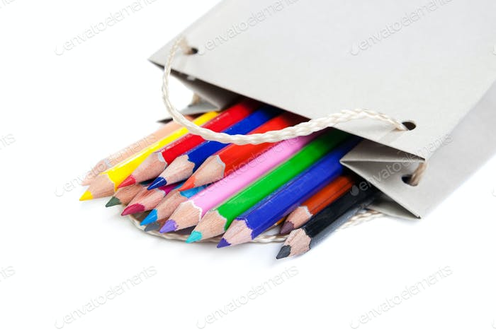 Colored pencils in a paper bag