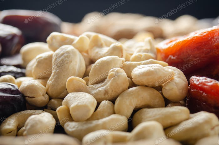 Closeup view at cashew nuts on kitchen table. Vegetarian food concept