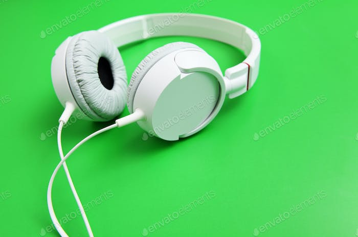 White headphone with green background