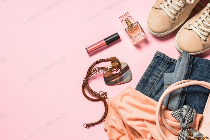 Woman flat lay background with cloth, accerrories and cosmetics
