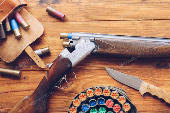 Hunting equipment. Shotgun, hunting cartridges and hunting knife