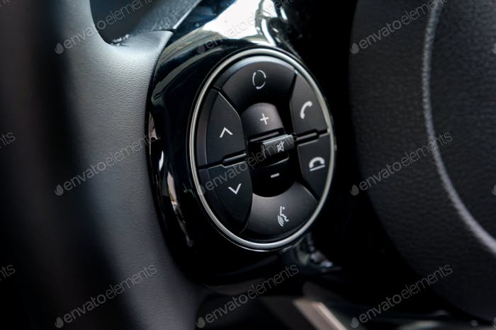 Phone and volume control buttons on the steering wheel close
