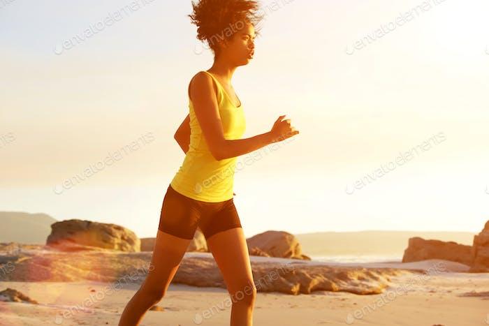 Young woman running at dusk