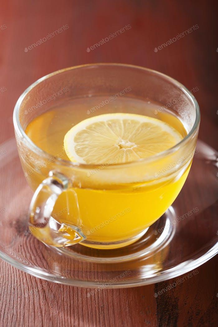 hot lemon ginger tea in glass cup