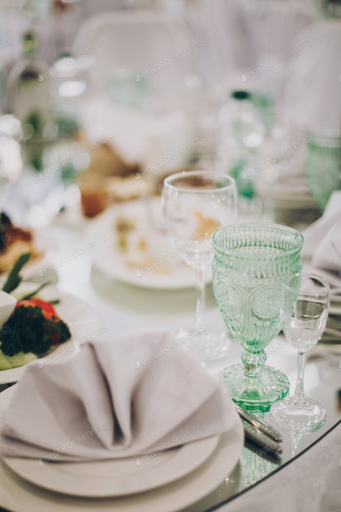 Wedding luxury table setting at reception in restaurant