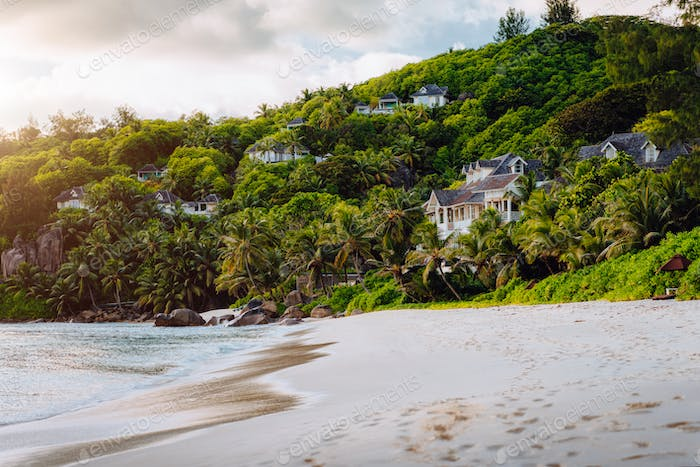 Mahe, Seychelles. Exotic tropical beach Anse Intendance in evening sunset light. Scenic view of