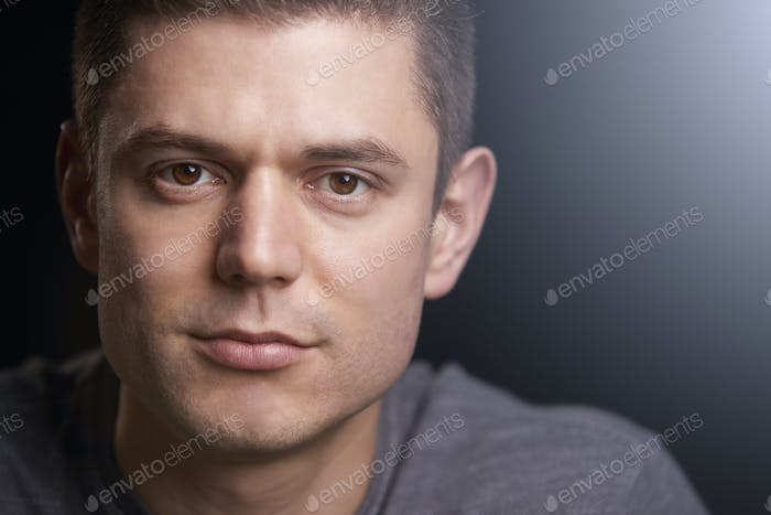 Close up portrait of a young white man looking to camera