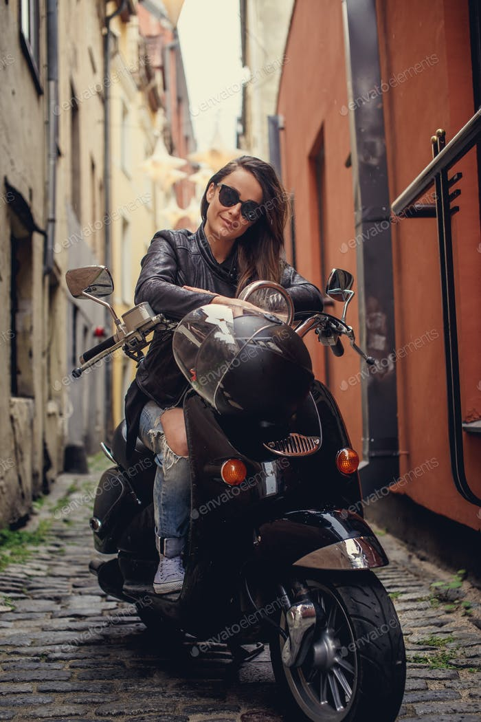 Casual girl on moto scooter.
