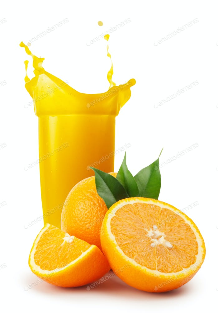 Glass of orange juice and oranges with leaves