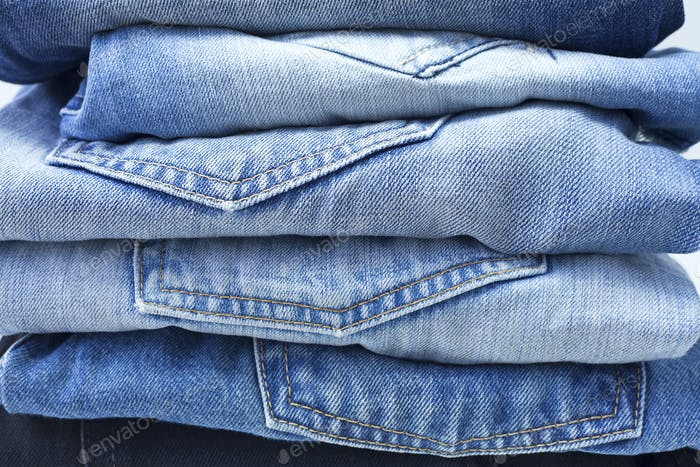 Stack of Blue and Black Jeans
