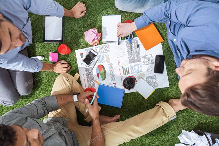 overhead view of business people working on new business plan, business teamwork
