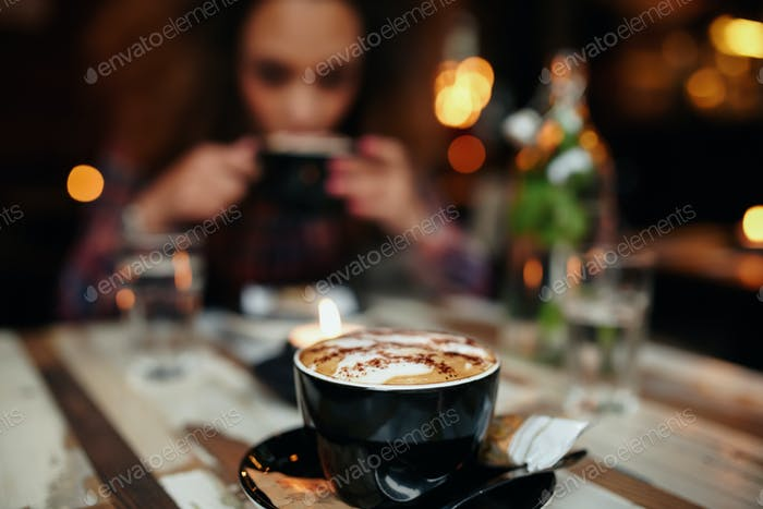 Cup of coffee on table at cafe