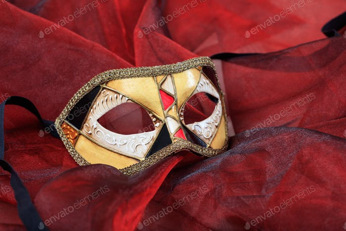 Carnival mask on red background